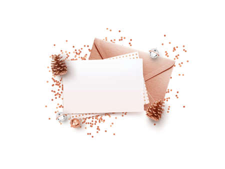 Empty memo and rose gold envelope  with Christmas decorations on white background