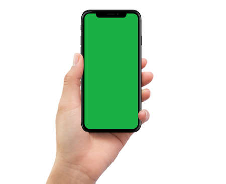 Isolated human left hand holding black mobile smartphone with green screen