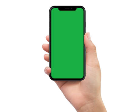 Isolated Isolated human right hand holding black mobile smartphone with green screen