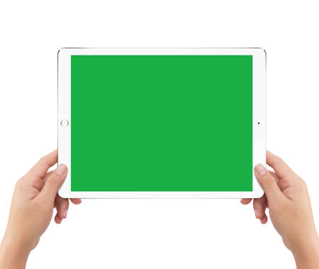 Isolated human two hands holding white tablet computer green screen mockup on white background