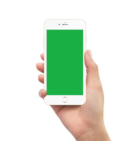 Isolated human hand holding green screen white mobile smart phone mockup on white background Stock Photo
