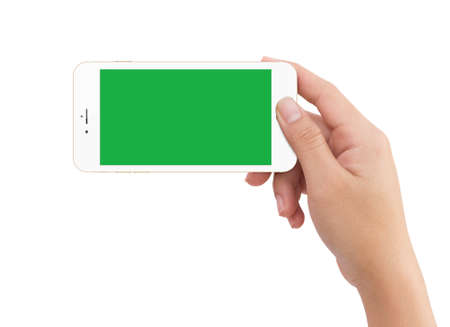 Isolated human right hand holding green screen white mobile smart phone mockup on white background