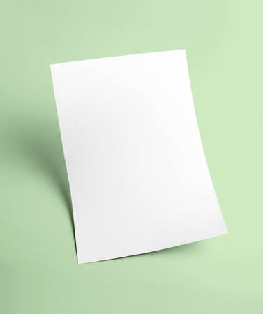 The white blank document paper template with green background
