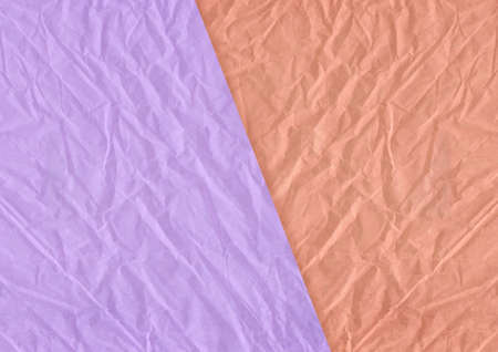 The orange, purple blank crumpled and grungy textured paper background
