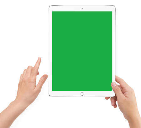Isolated human right hand holding white tablet computer green screen mockup on white background