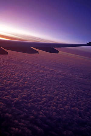 The plane, aeroplane wing, clouds,  gradient sky from aerial view Banco de Imagens