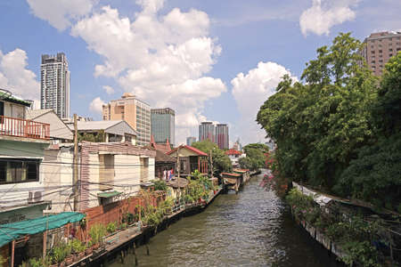 The Thailand residential apartment, river, footpath and tree at daytime