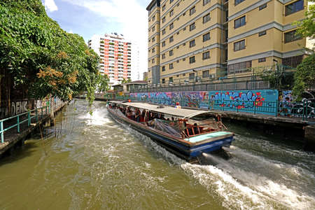 The Thailand tourist canal boat on village river at daytime Editorial