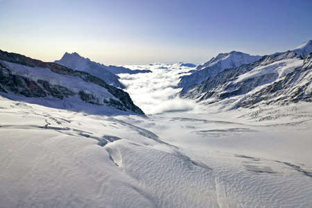 The peak and sea of clouds in Switzerland Grindelwald snow mountain