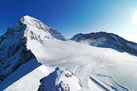 The peak of Switzerland Grindelwald snow mountain with blue sky Banco de Imagens