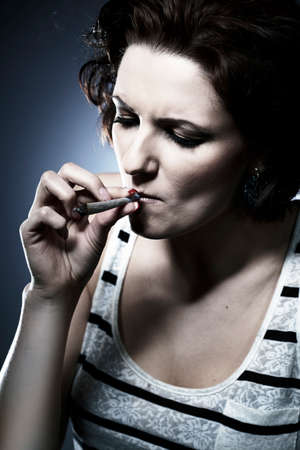 dependance: Lady using smoking drugs Stock Photo