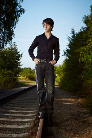 heartsickness: Moody young man acting his emotions on outdoor location when posing for illustration photos. Stock Photo