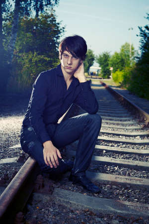 Moody young man acting his emotions on outdoor location when posing for illustration photos. Stock Photo