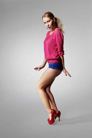 fashion photos: Girl posing in studio for fashion photos in several styles
