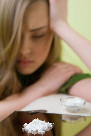 doped: Girl posing in studio as a cocaine consumer