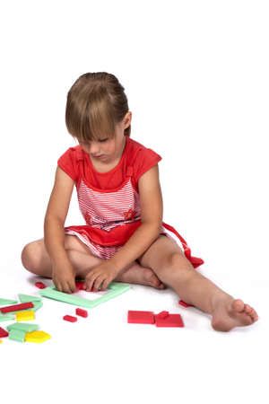 didactic: Children at play with set of rubber foam toys in studio on white background