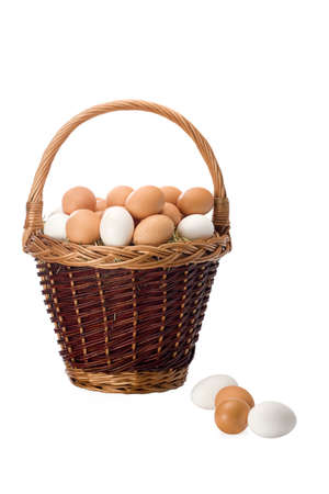 rustical: Basket of fresh eggs isolated on white background in studio