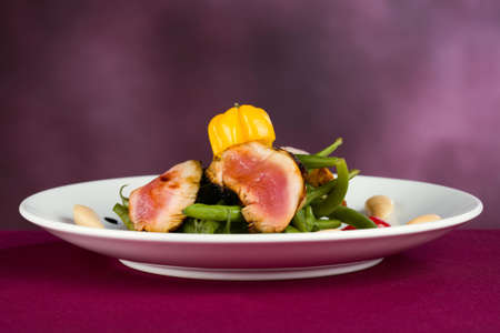 sirloin: Green beans with Sirloin on white plate
