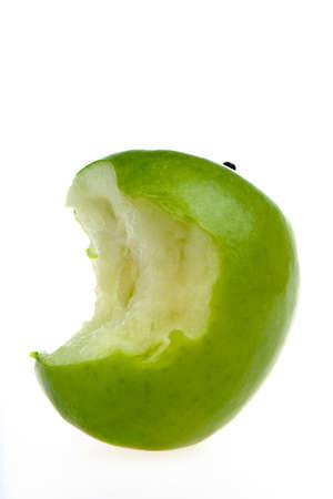 Green bitten apple on a white background