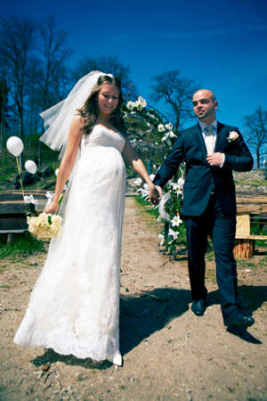 bridal gown: Nice young couple on wedding day - bride in bridal gown