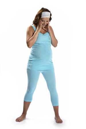 fashion photos: Pregnant lady in studio posing in dress for jogging and exercising for fitness fashion photos