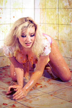 ghoulish: Young woman playing with melted Jelly in white tile room
