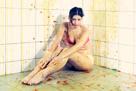 depraved: Young woman playing with melted Jelly in white tile room