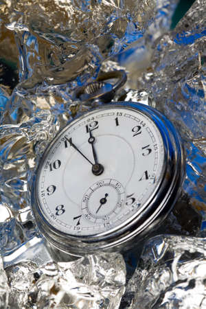 melted: Older watch on melted crystal ice cubes Stock Photo