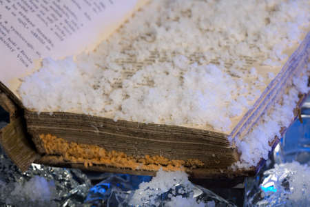 conserving: Scarce book damaged by water during floods on frozen ice Stock Photo