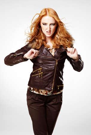 fashion photos: Beautiful redhead woman posing in studio for figure and portrait fashion photos