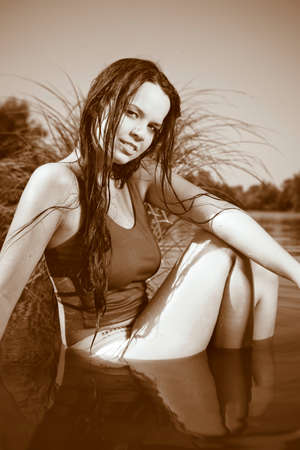 swimm: Young lady in swimm suit. Posing in summer late day light by the lake for fashion and portrait photos.