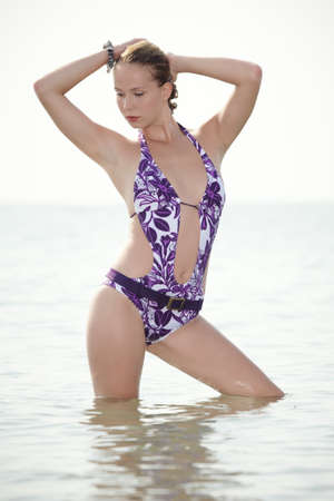 tourist resort: Young lady posing on Italian beach near tourist resort Caorle in swimmsuit.