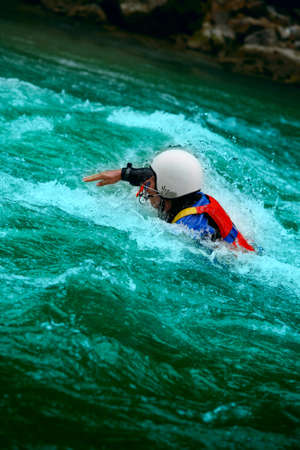 adrenalin: Brave man rides down a wild river kayaking