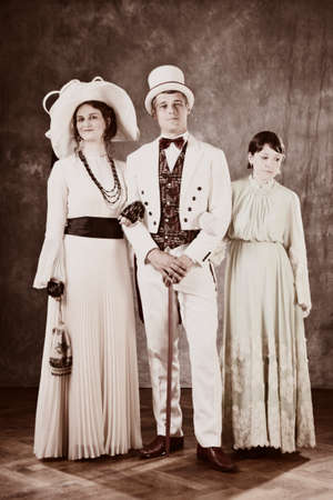 sedition: Family of the past times - married couple in secession style dresses with daughter. Stock Photo