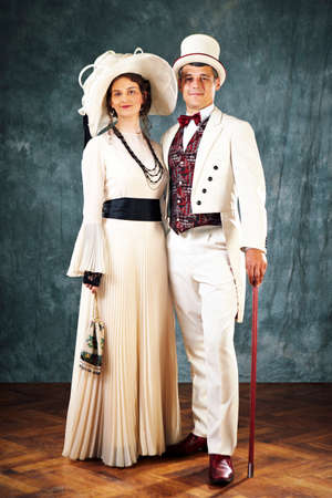 Spouses of past - secession style pair posing in studio as married couple. Banco de Imagens