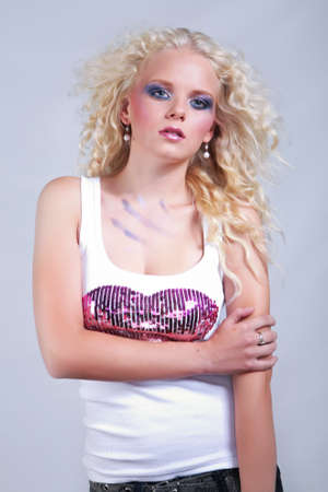 fashion photos: Young nice lady portraited in studio and posing for various fashion photos. Stock Photo
