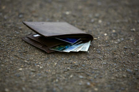 Lost man wallet at the park sidewalk