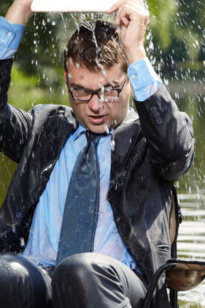 freak out: Crazy businessman pouring water out of computer Stock Photo