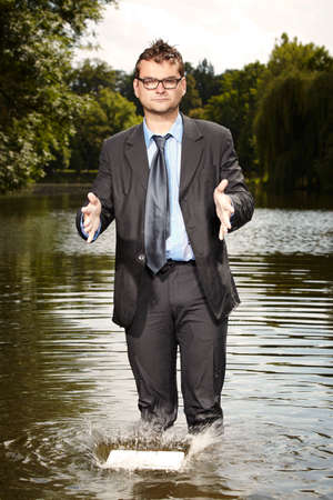freak out: Crazy man in suit drop laptop to water Stock Photo