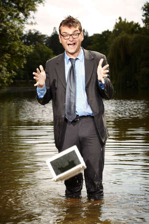 Crazy businessman in suit drop notebook to water