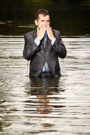 freak out: Crazy businessman in suit leaving summer river Stock Photo