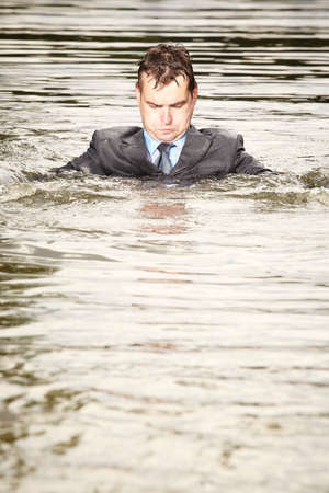 freak out: This man is a bit crazy - swimming in suit