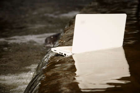 freak out: Notebook dived in river water Stock Photo