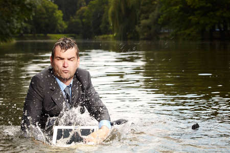 freak out: Desperate businessman in suit relaxing after burning out