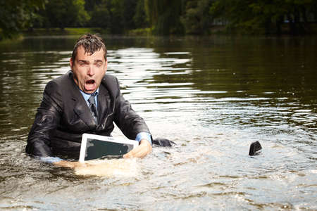 freak out: Terrible businessman in suit relaxing after burning out