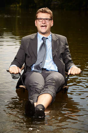 Funny businessman in suit relaxing after burning out Stock Photo