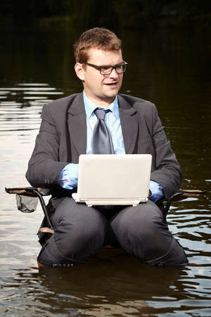 freak out: Crazy businessman in suit working in river
