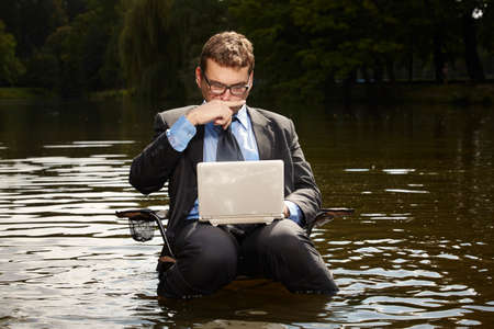 freak out: Crazy businessman in suit working in summer water Stock Photo