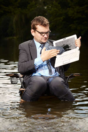 freak out: Good businessman in suit relaxing after burning out Stock Photo