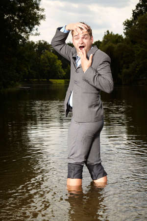 Crazy businessman in suit refreshing after burning out